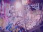 No boletim #3 do banco de dados do ITTC analisamos como a desigualdade de gênero no mercado de trabalho atinge as mulheres migrantes em conflito com a lei. Na foto há uma banca de doces e uma mulher realizando a venda. Foto: Mídia Fora de Eixo.